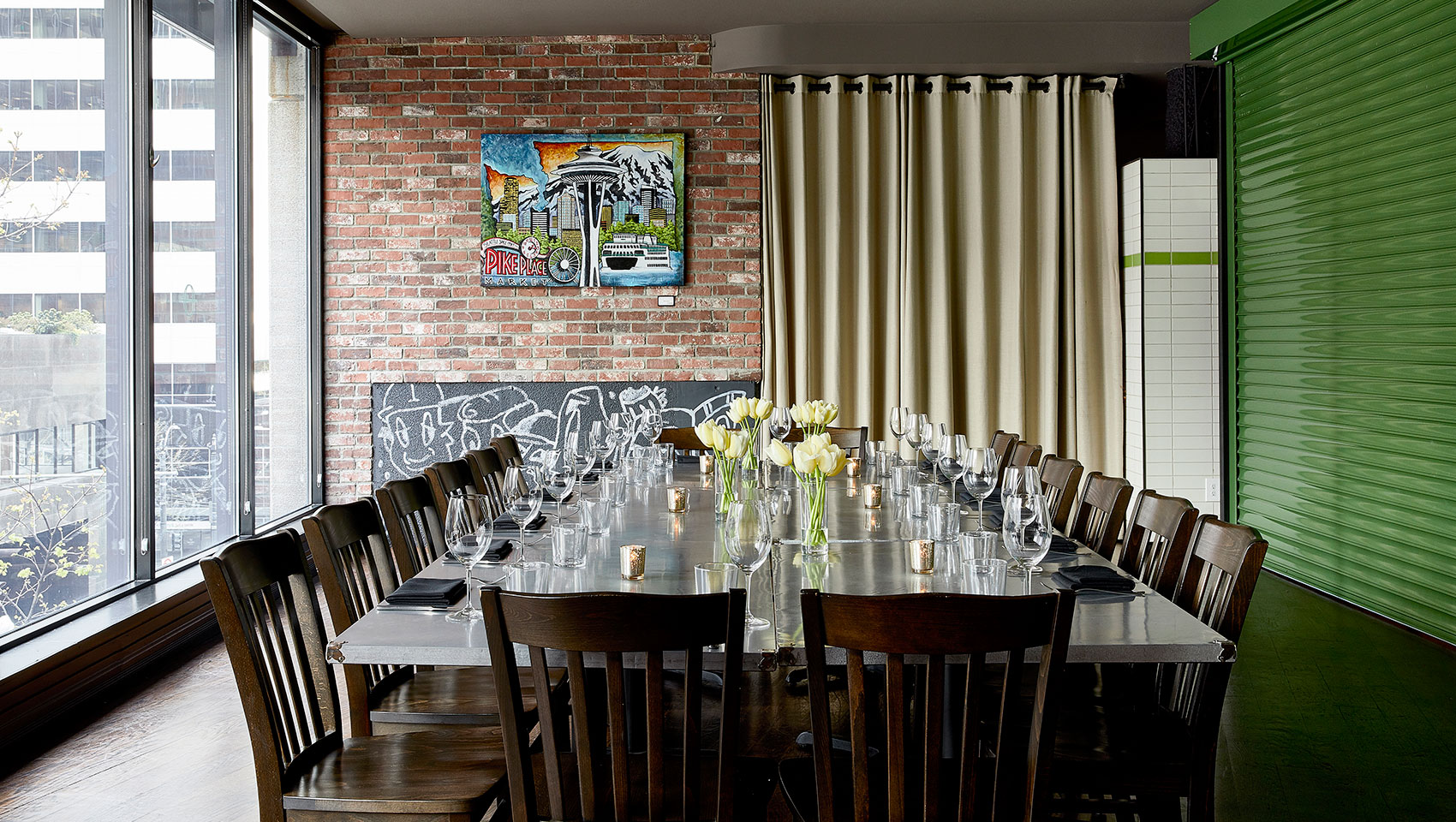 Garage style private dining space overlooking downtown Seattle