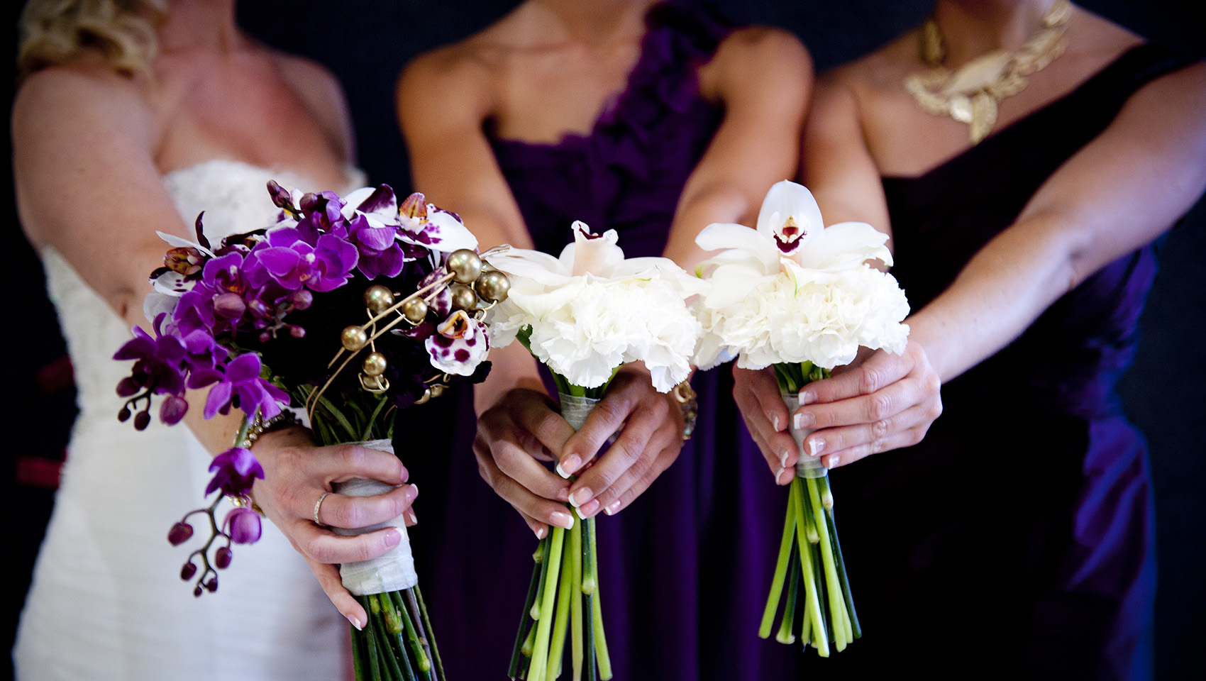 bridal party with bouquet of flowers